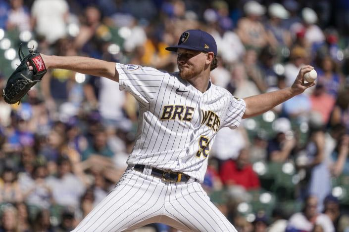 Milwaukee Brewers starting pitcher Eric Lauer throws during the first inning of a baseball game against the Chicago Cubs Sunday, Sept. 19, 2021, in Milwaukee. (AP Photo/Morry Gash)