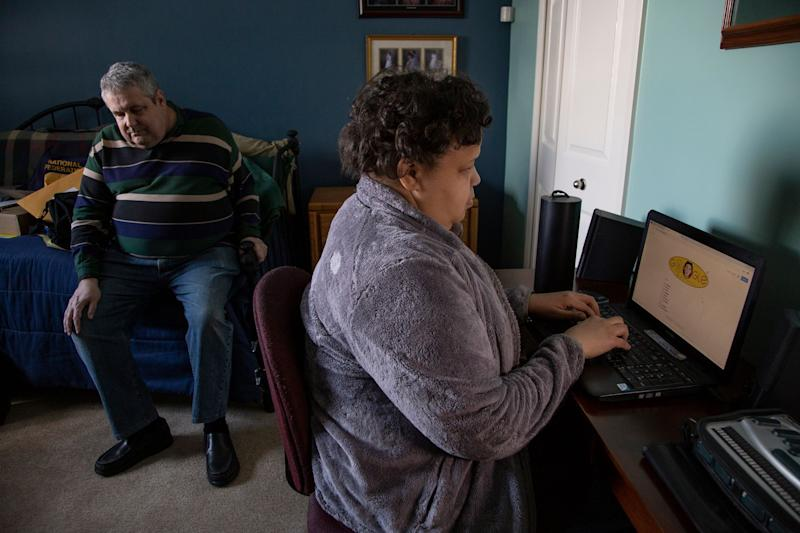 State president of National Federation of the Blind Mike Powell, 65, of Warren, left, and his friend Sabrina Simmons, 46, of Detroit, who is the Detroit president chapter of National Federation of the blind, demonstrate some accessibility issues websites have for navigating for the visually impaired Thursday, March 7, 2019 at Powell's home in Warren. Powell and Simmons are both blind and point out that minor changes in coding to certain websites would make their use universal to all users.
