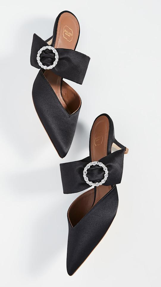 """<p>These <a href=""""https://www.popsugar.com/buy/Malone-Souliers-Maite-Crystal-Ms-45mm-Mules-533119?p_name=Malone%20Souliers%20Maite%20Crystal%20Ms%2045mm%20Mules&retailer=shopbop.com&pid=533119&price=313&evar1=fab%3Aus&evar9=44343600&evar98=https%3A%2F%2Fwww.popsugar.com%2Ffashion%2Fphoto-gallery%2F44343600%2Fimage%2F47028763%2FMalone-Souliers-Maite-Crystal-Ms-45mm-Mules&list1=shopping%2Csales%2Cwinter%2Csale%20shopping&prop13=mobile&pdata=1"""" rel=""""nofollow"""" data-shoppable-link=""""1"""" target=""""_blank"""" class=""""ga-track"""" data-ga-category=""""Related"""" data-ga-label=""""https://www.shopbop.com/maite-crystal-mule-malone-souliers/vp/v=1/1527393031.htm?folderID=15539&amp;fm=other-shopbysize-viewall&amp;os=false&amp;colorId=1071C&amp;ref=SB_PLP_NB_28"""" data-ga-action=""""In-Line Links"""">Malone Souliers Maite Crystal Ms 45mm Mules</a> ($313, originally $625) are perfect for New Year's Eve.</p>"""