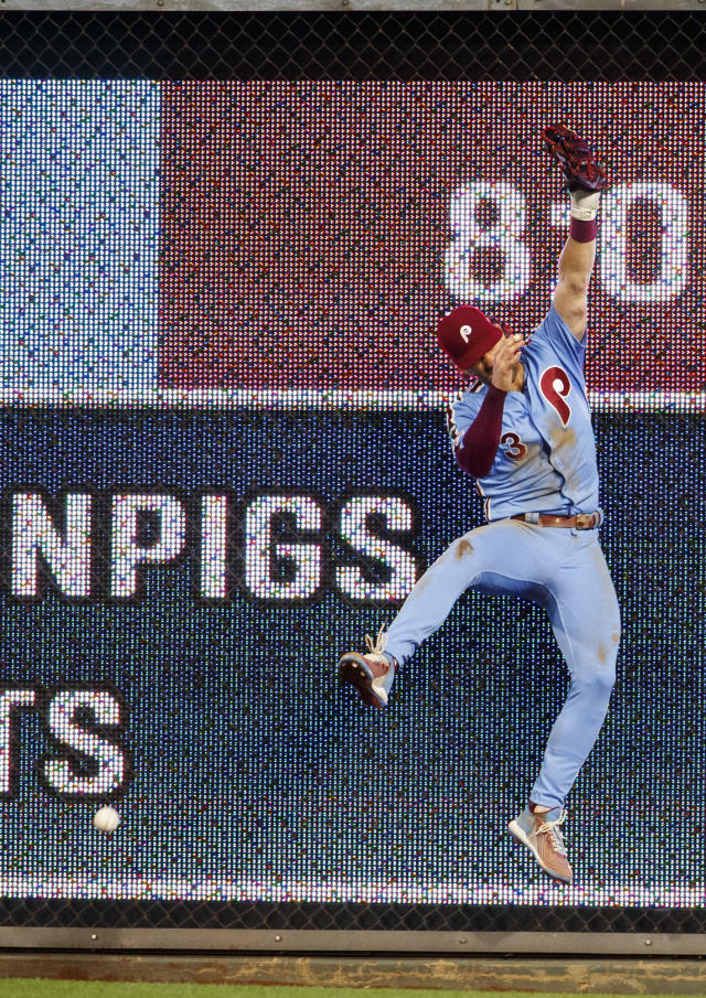 Philadelphia Phillies right fielder Bryce Harper is unable to make the leaping catch on the hit by Chicago Cubs' Ian Happ during the fourth inning of a baseball game, Thursday, Aug. 15, 2019, in Philadelphia. (AP Photo/Chris Szagola)