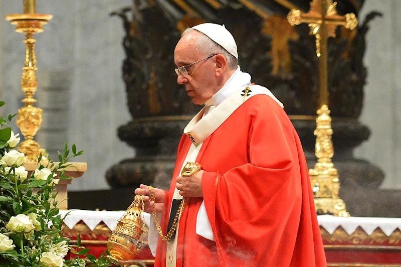 Pope Francis swings a censer as he celebrates a mass on June 29, 2014 at the Vatican