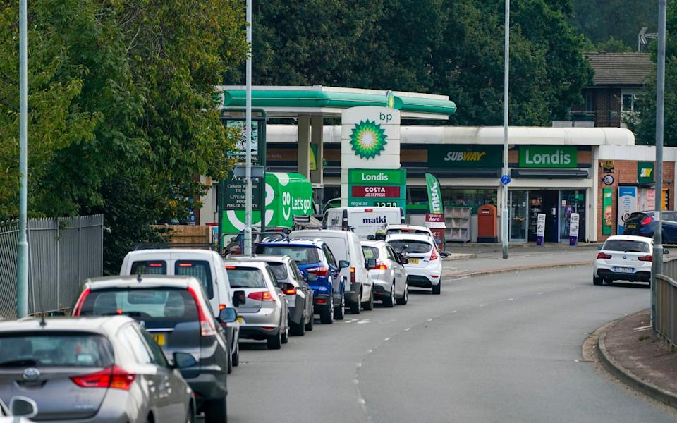 Panic buying gripped petrol forecourts across Britain over the weekend, such as at this BP petrol station in Bracknell, Berkshire - Steve Parsons/PA Wire