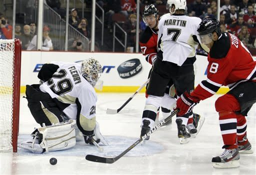 New Jersey Devils' Dainius Zubrus (8), of Lithuania, scores a goal on Pittsburgh Penguins' Marc-Andre Fleury (29) during the second period of an NHL hockey game on Sunday, Feb. 5, 2012, in Newark, N.J. (AP Photo/Julio Cortez)