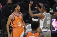 Phoenix Suns guard Cameron Payne, left, and Los Angeles Clippers guard Terance Mann scuffle during the first half in Game 4 of the NBA basketball Western Conference Finals Saturday, June 26, 2021, in Los Angeles. (AP Photo/Mark J. Terrill)