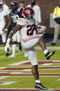 Alabama running back Najee Harris dances after breaking a Mississippi tackle and scoring a touchdown during the first half of an NCAA college football game in Oxford, Miss., Saturday, Oct. 10, 2020. (AP Photo/Rogelio V. Solis)