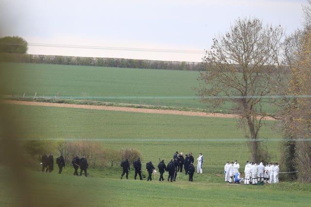 Police forensic and specialist search officers gather near the scene at Akholt Wood, close to the hamlet of Snowdown, near Aylesham, Kent, where the body of PCSO Julia James was discovered