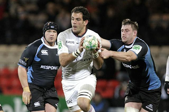 Glasgow Warriors' Aly Muldowney (R) tackles Toulouse's Gregory Lamboley (C) during a Heineken Cup, pool six, rugby union match at Firhill Stadium, Glasgow, Scotland, on December 10, 2010. AFP PHOTO/GRAHAM STUART (Photo credit should read GRAHAM STUART/AFP/Getty Images)