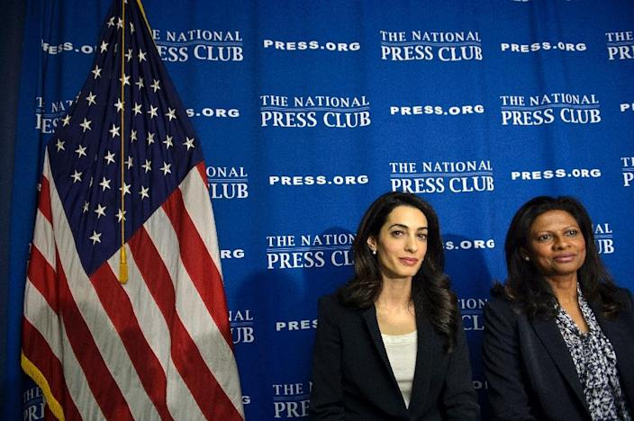 Lawyer Amal Clooney (L) and Laila Ali, wife of Mohamed Nasheed, sit together after a press conference at the National Press Club on April 30, 2015 in Washington, DC, regarding attempts to get Ali's husband Nasheed released from prison (AFP Photo/Brendan Smialowski)