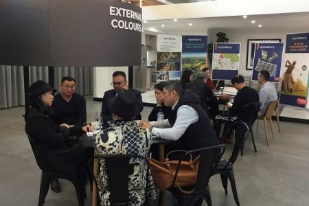 Investors from Hong Kong visit a Tick Homes display centre during a property tour in Melbourne