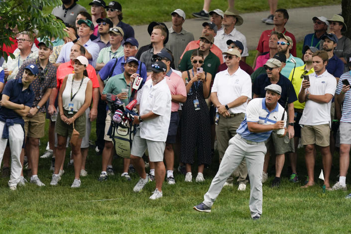 Bryson DeChambeau watches his shot on the 11th hole during the second round of the Memorial golf tournament, Friday, June 4, 2021, in Dublin, Ohio. (AP Photo/Darron Cummings)