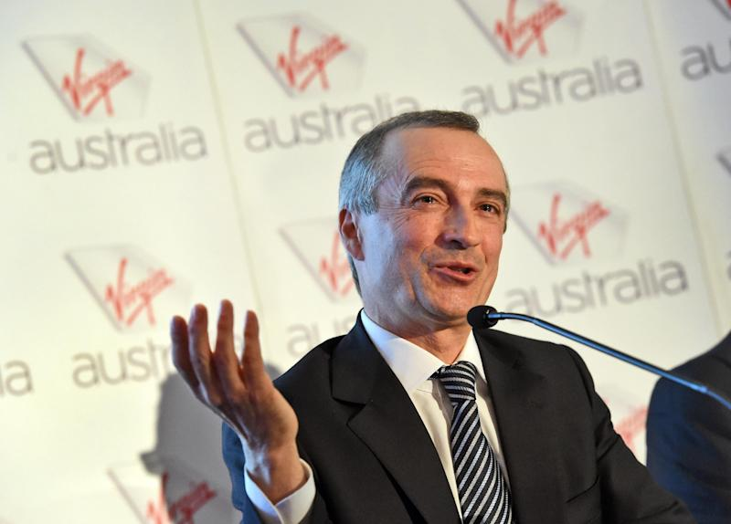 Virgin Australia chief executive John Borghetti speaks during a company results press conference in Sydney on August 29, 2014 (AFP Photo/William West)