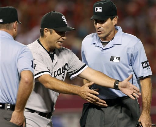 White Sox manager Robin Ventura disputes a call with home plate umpire Angel Hernandez, right, in the fourth inning of a baseball game against the Los Angeles Angels in Anaheim, Calif., on Saturday, Sept. 22, 2012. Ventura was thrown out of the game. (AP Photo/Christine Cotter)