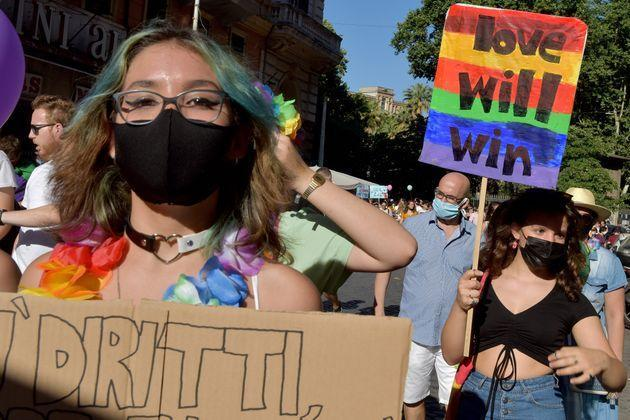 ROME, ITALY - JUNE 26: People with a sign saying Love will Win, take part in Rome Pride, the LGBTQIA+ parade, on June 26, 2021 in Rome, Italy. The Italian prime minister defended parliament after the Vatican requested a revision on an anti-discrimination draft bill that provides protection for LGBTQ persons, saying the new law could interfere with religious freedoms. (Photo by Simona Granati - Corbis/Corbis via Getty Images) (Photo: Simona Granati - Corbis via Getty Images)