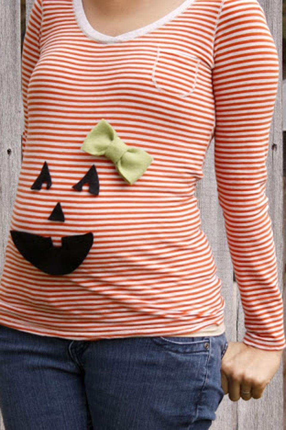 """<p>Skip the Halloween stress with this easy-to-make pumpkin costume.</p><p><strong>Get the tutorial at <a href=""""http://www.deliacreates.com/this-looked-much-better-in-my-head/"""" rel=""""nofollow noopener"""" target=""""_blank"""" data-ylk=""""slk:Delia Creates"""" class=""""link rapid-noclick-resp"""">Delia Creates</a>.</strong> </p><p><a class=""""link rapid-noclick-resp"""" href=""""https://www.amazon.com/Darice-FLT-0232-Adhesive-Felties-Sheet/dp/B0054G5XA2/?tag=syn-yahoo-20&ascsubtag=%5Bartid%7C10050.g.4972%5Bsrc%7Cyahoo-us"""" rel=""""nofollow noopener"""" target=""""_blank"""" data-ylk=""""slk:SHOP BLACK ADHESIVE FELT"""">SHOP BLACK ADHESIVE FELT</a></p>"""