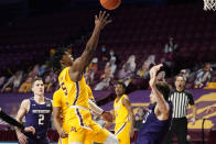 Minnesota's Marcus Carr (5) shoots as Northwestern's Ryan Young, right, falls following a collision with Carr in the first half of an NCAA college basketball game, Thursday, Feb. 25, 2021, in Minneapolis. (AP Photo/Jim Mone)