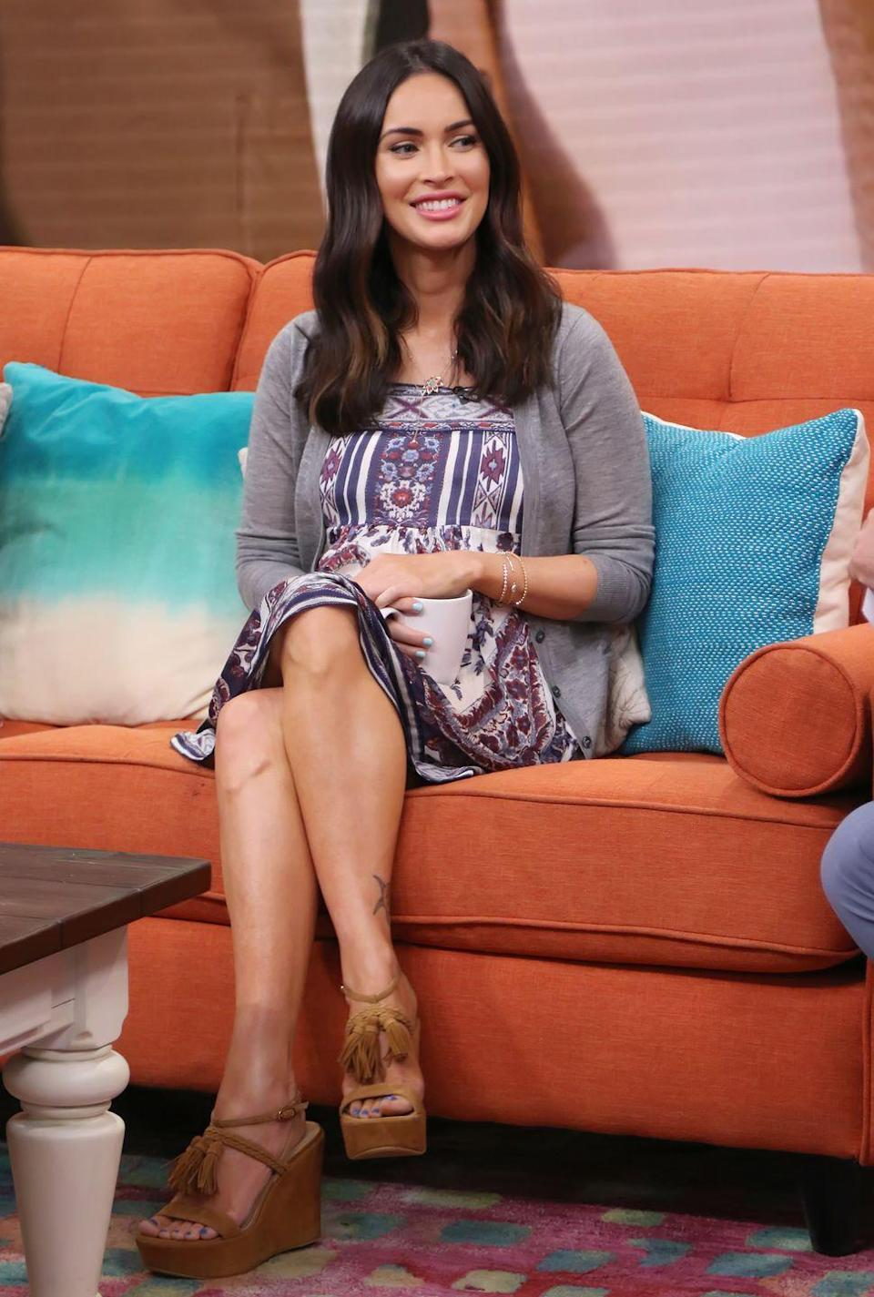 <p>The star was seen on Univision's morning show wearing a pair of brown wedges, an Aztec-printed dress and grey cardigan. </p>