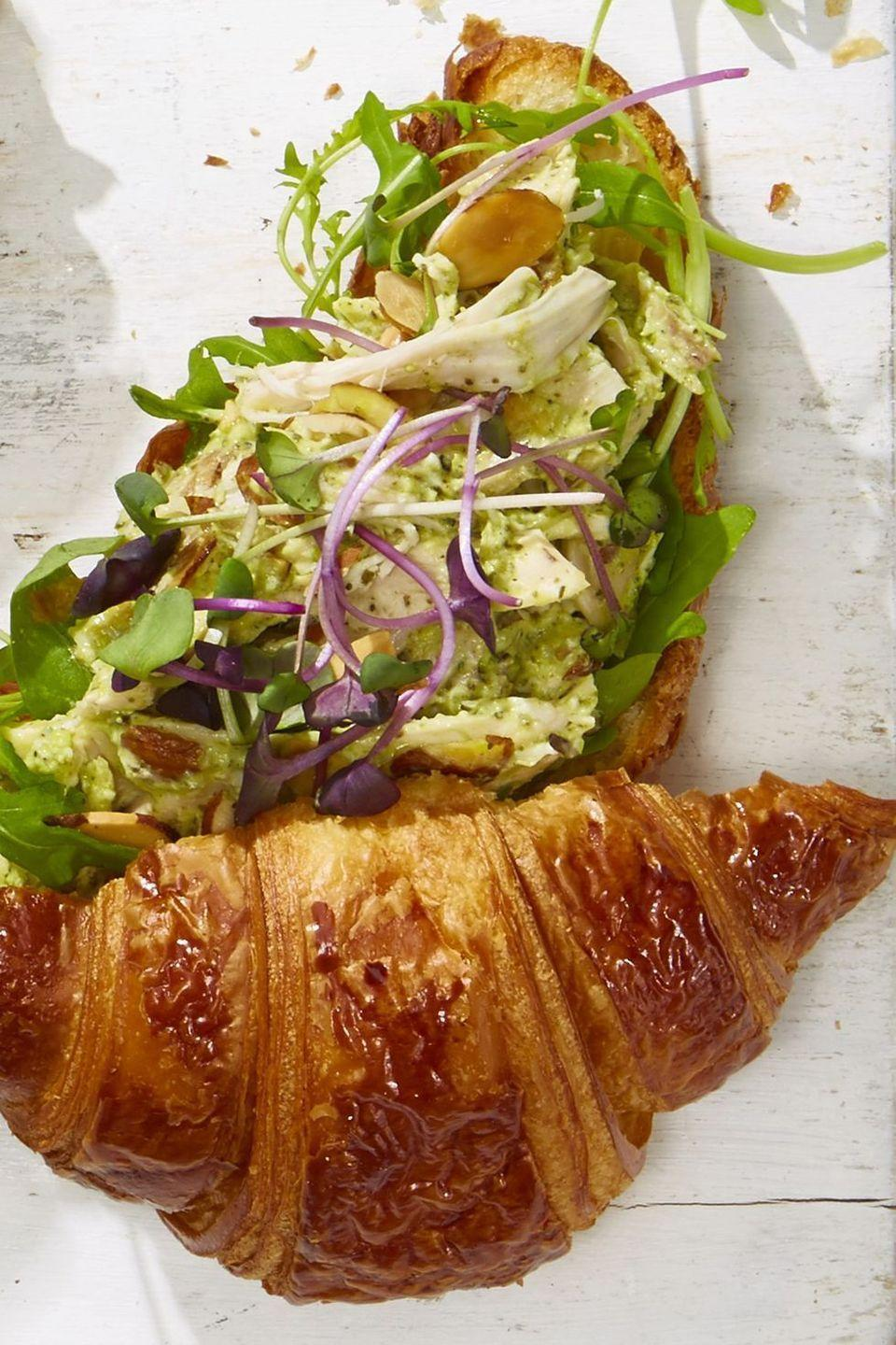 """<p>No matter if you made turkey or chicken on Thanksgiving, you can follow this simple step-by-step for a delicious lunch.</p><p><em><a href=""""https://www.goodhousekeeping.com/food-recipes/easy/a21752098/pesto-chicken-salad-croissants-recipe/"""" rel=""""nofollow noopener"""" target=""""_blank"""" data-ylk=""""slk:Get the recipe for Pesto Chicken Salad Croissants »"""" class=""""link rapid-noclick-resp"""">Get the recipe for Pesto Chicken Salad Croissants »</a></em></p>"""