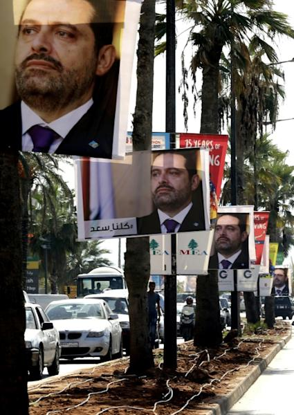 "Photographs of resigned Lebanese Prime Minister Saad Hariri line Beirut's seaside corniche on November 10, 2017, with a caption in Arabic reading: ""#We_are_all_Saad"""