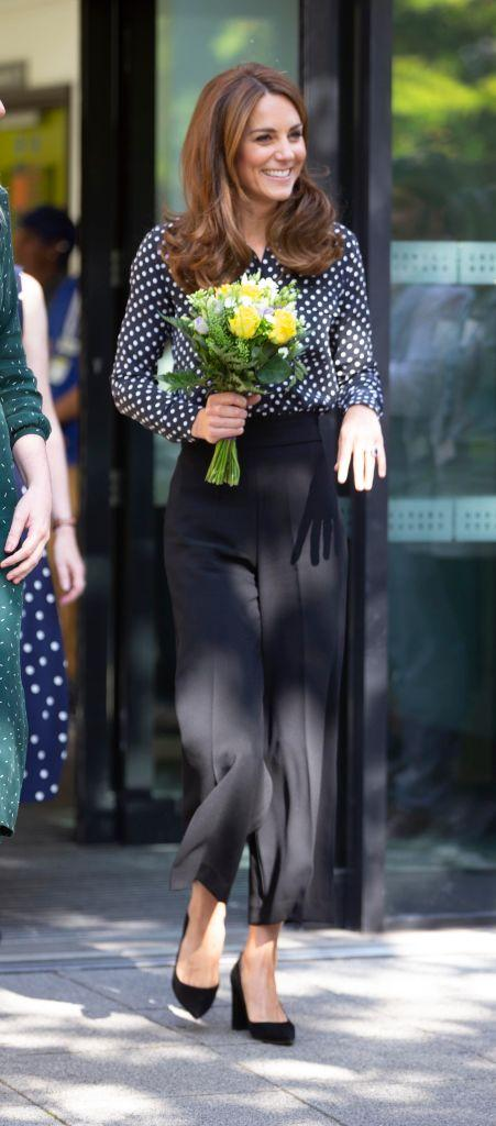 The Duchess looked chic in cropped trousers and a polka dot shirt [Photo: Getty]