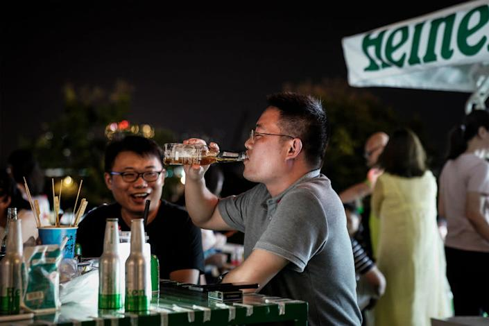 "Residents drink during the Wuhan Beer Festival on August 21, 2020 in Wuhan, Hubei, China. <span class=""copyright"">Getty Images</span>"