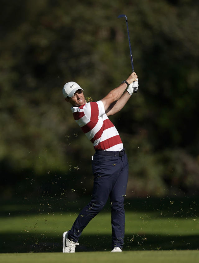 Rory McIlroy, of Northern Ireland, hits his second shot on the 13th hole during the second round of the Genesis Invitational golf tournament at Riviera Country Club, Friday, Feb. 14, 2020, in the Pacific Palisades area of Los Angeles. (AP Photo/Ryan Kang)