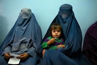 Two women and a child at the clinic, run by the Swedish Committee for Afghanistan (AFP/Elise BLANCHARD)