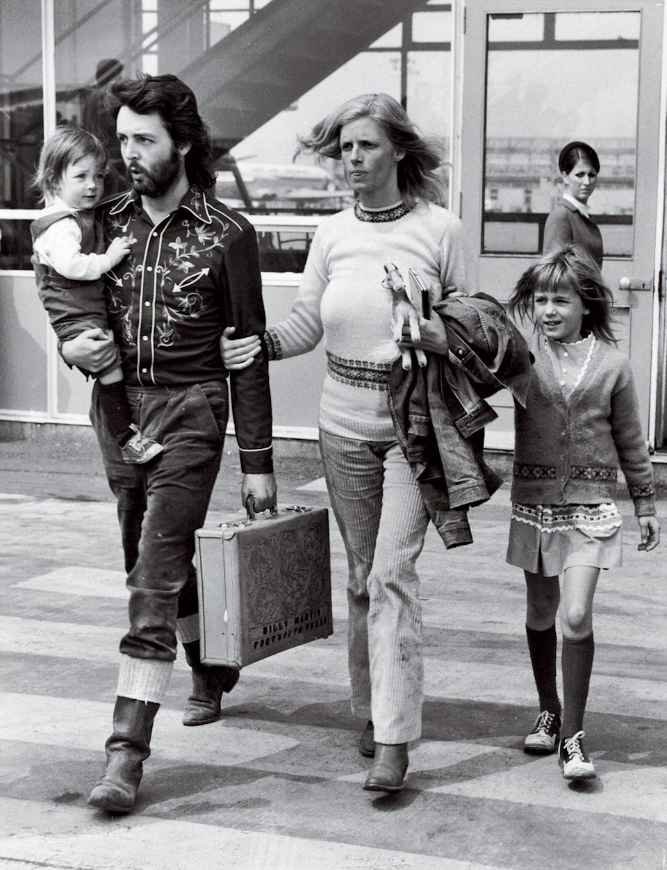 <p>Taking a trip one year after the Beatles disbanded, the couple (at London's Gatwick Airport with daughters Mary, left, and Heather) opted for funky over flashy.</p>