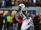 CORRECTS ID TO TCU'S DEANTE' GRAY, NOT WEST VIRGINIA'S RUSHEL SHELL - TCU's Deante' Gray runs by the West Virginia defense during the first quarter of an NCAA college football game against West Virginia in Morgantown, W.Va., Saturday, Nov. 1, 2014. (AP Photo/Tyler Evert)