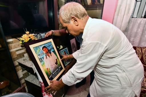 Gopal Chandra Das, father of lynching victim Nilotpal Das, with a picture of his son at his residence in Guwahati, the capital city of India's northeastern state of Assam, pictured on July 9, 2018