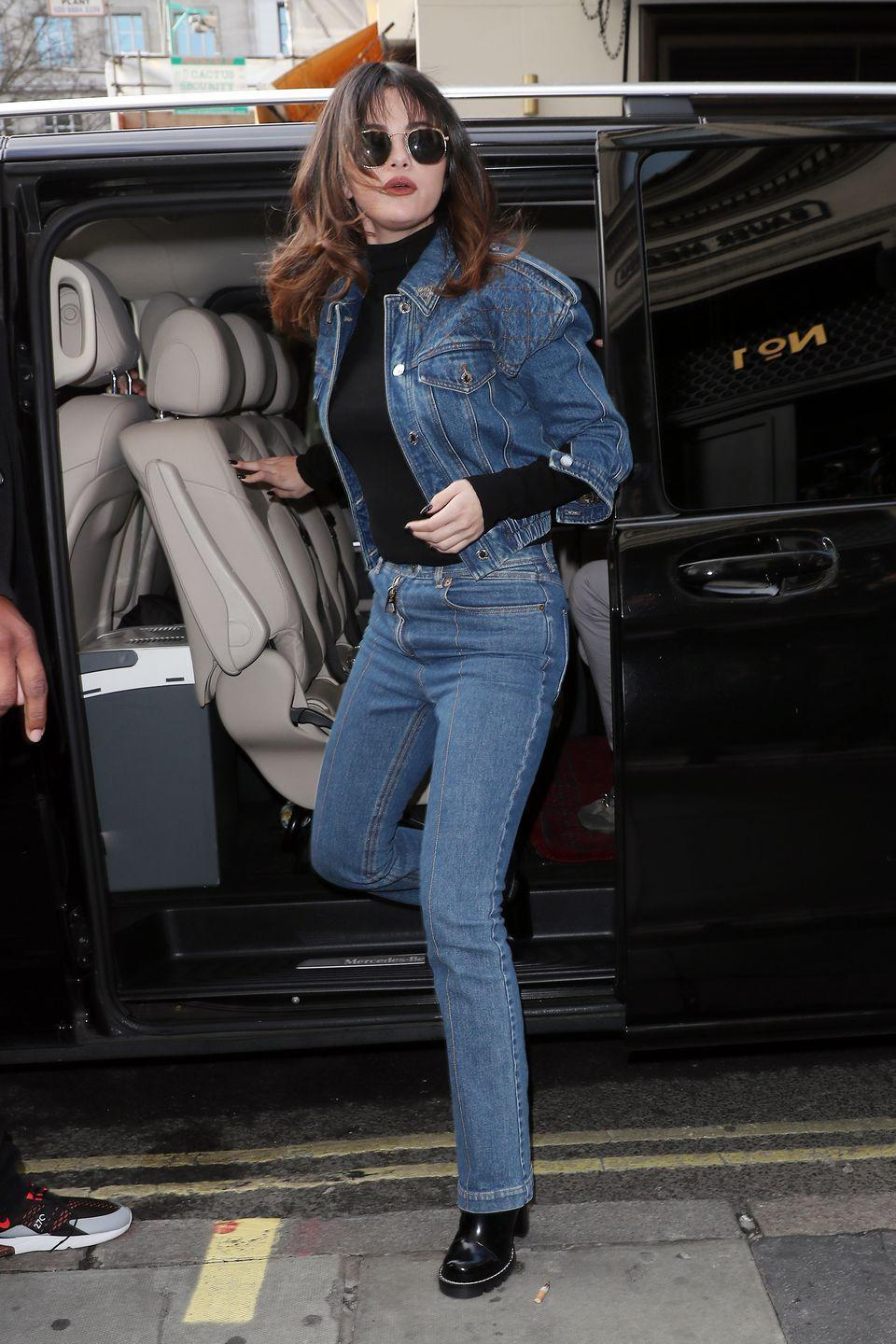 "<p>Heading to the KISS FM UK Breakfast Radio Studios in London, where she <a href=""https://www.elle.com/culture/celebrities/a30194470/selena-gomez-blunt-bangs-london-photo/"" rel=""nofollow noopener"" target=""_blank"" data-ylk=""slk:debuted"" class=""link rapid-noclick-resp"">debuted</a> a new set of bangs and Louis Vuitton ensemble.</p>"