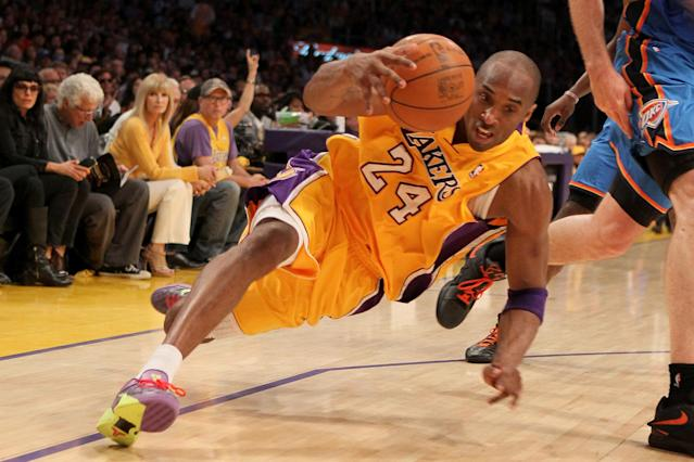 LOS ANGELES, CA - MAY 19: Kobe Bryant #24 of the Los Angeles Lakers falls as he dribbles the ball in the second quarter while taking on the Oklahoma City Thunder in Game Four of the Western Conference Semifinals in the 2012 NBA Playoffs on May 19 at Staples Center in Los Angeles, California. NOTE TO USER: User expressly acknowledges and agrees that, by downloading and or using this photograph, User is consenting to the terms and conditions of the Getty Images License Agreement. (Photo by Stephen Dunn/Getty Images)