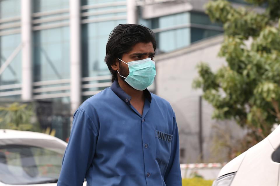 ISLAMABAD, PAKISTAN - FEBRUARY 27: A man wears a medical mask as a precaution against coronavirus after Pakistan Health Minister Zafar Mirza announced that the first case of coronavirus was seen in the country, in Islamabad, Pakistan on February 27, 2020. (Photo by Muhammed Semih Ugurlu/Anadolu Agency via Getty Images)