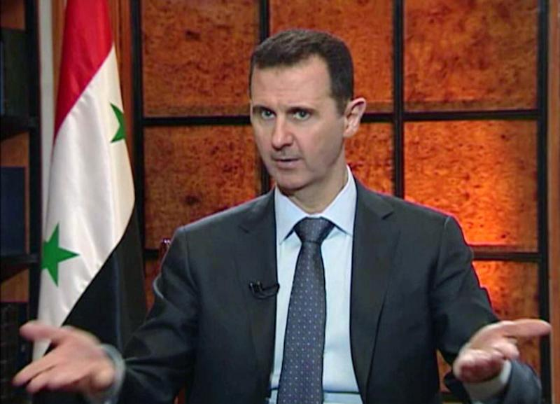 "In this image from video broadcast on Syrian state television Wednesday, April 17, 2013, President Bashar Assad speaks during an interview. Syria's president accused the West on Wednesday of backing al-Qaida in his country's civil war, warning it will pay a price ""in the heart"" of Europe and the United States as the terror network becomes emboldened. The rare TV interview comes as the embattled president's military is fighting to reverse rebel advances, with a rocket attack killing at least 12 people in a central village on Wednesday. (AP Photo/Syrian State TV via AP video)"