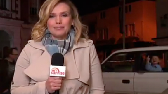 Young boy flips off royal reporter in hilarious live cross