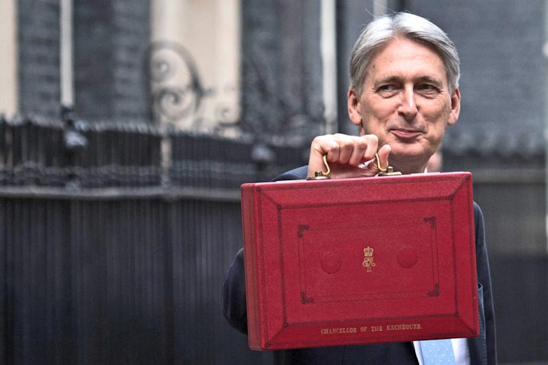 Chancellor Philip Hammond holding his red ministerial box outside 11 Downing Street, London, before heading to the House of Commons to deliver his Budget.