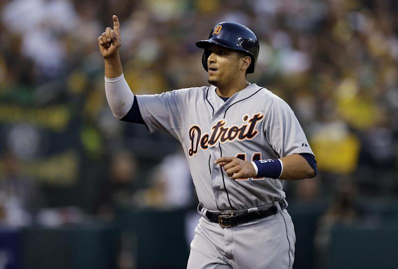 Detroit Tigers Victor Martinez celebrates after scoring a single by Alex Avila in the first inning of Game 1 of the American League baseball division series against the Oakland Athletics in Oakland, Calif., Friday, Oct. 4, 2013. (AP Photo/Ben Margot)