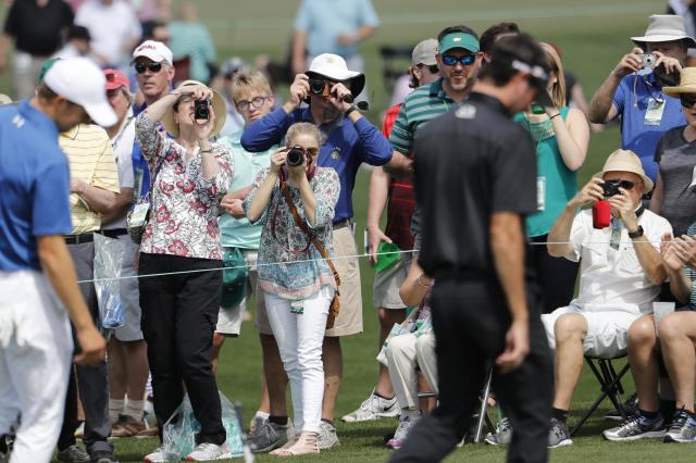 Golf patrons use cameras to take pictures, as cell phones are banned at Augusta National, during the second day of practice for the 2018 Masters golf tournament at Augusta National Golf Club in Augusta, Georgia, U.S. April 3, 2018. REUTERS/Jonathan Ernst