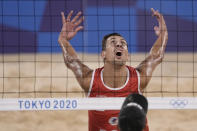 Oleg Stoyanovskiy, of the Russian Olympic Committee, prepares to take a shot during a men's beach volleyball quarterfinal match against Germany at the 2020 Summer Olympics, Wednesday, Aug. 4, 2021, in Tokyo, Japan. (AP Photo/Petros Giannakouris)