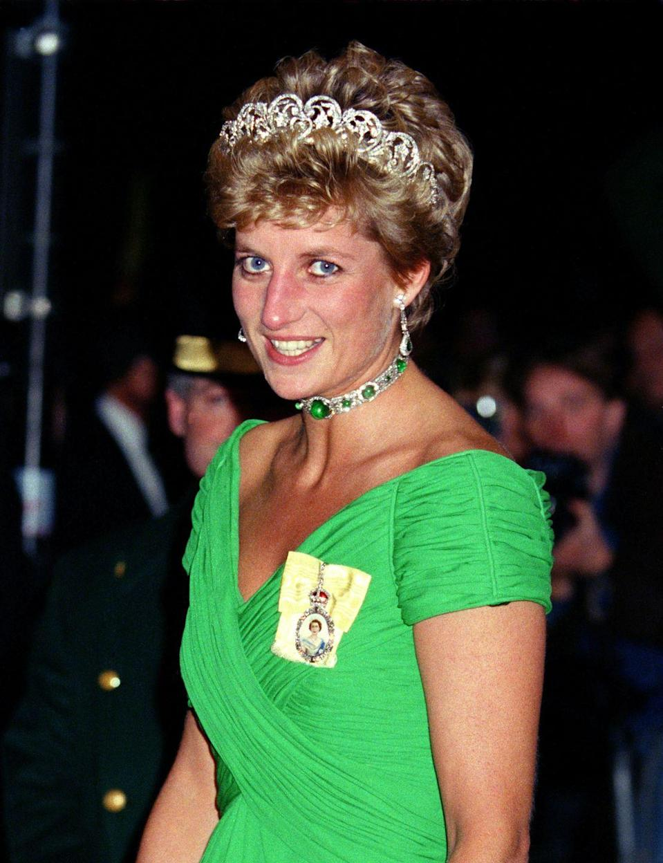 <p>For a banquet at London's Dorchester Hotel, Diana opted for green jewels to match her Kelly green dress. The Princess brought out Queen Mary's emerald and diamond choker necklace, alongside the Spencer tiara and her Royal Order. </p>