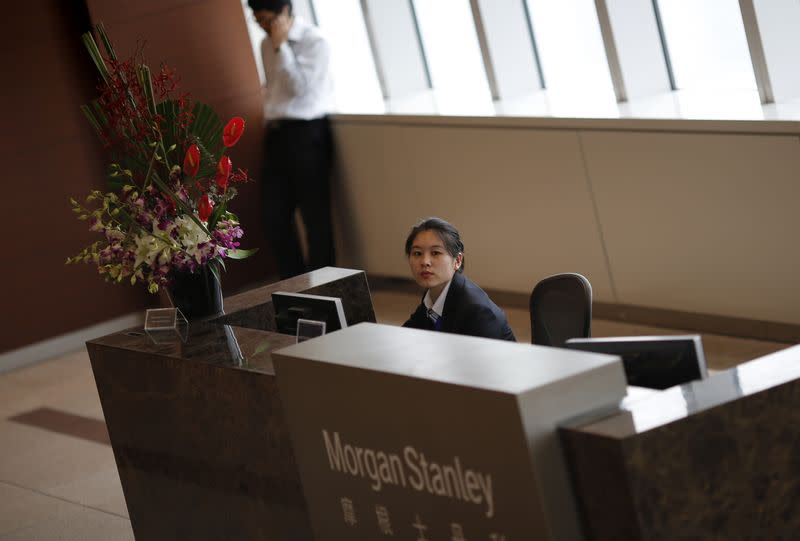 A receptionist sits at a Morgan Stanley office which was visited by Chinese investigators in Shanghai