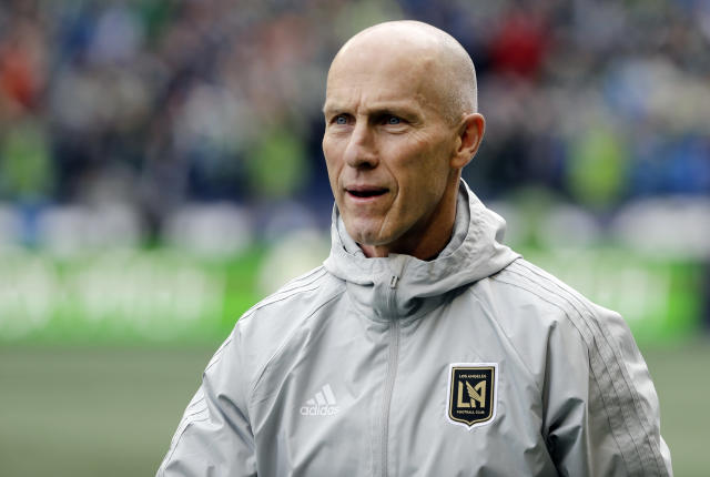 FILE - In this March 4, 2018, file photo, Los Angeles head coach Bob Bradley walks on the pitch before an MLS soccer match against the Seattle Sounders in Seattle. Six coaches begin their first full MLS season with a new team, a league record. Most notable is Bradley, who won his debut with LAFC. (AP Photo/Ted S. Warren, File)
