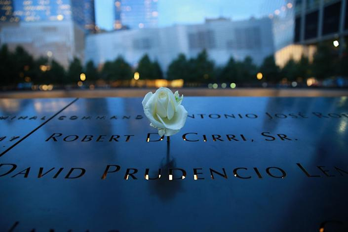 <p>A rose is placed on one of panels surrounding the south pool at The National September 11 Memorial & Museum in New York City. (Photo: Gordon Donovan/Yahoo News) </p>