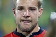 <p>Tom Mitchell of Britain reacts with tears in his eyes following a loss to Fiji in the gold medal match of the mens rugby sevens at the 2016 Summer Olympics in Rio de Janeiro, Brazil, Thursday, Aug. 11, 2016. (AP Photo/Robert F. Bukaty) </p>