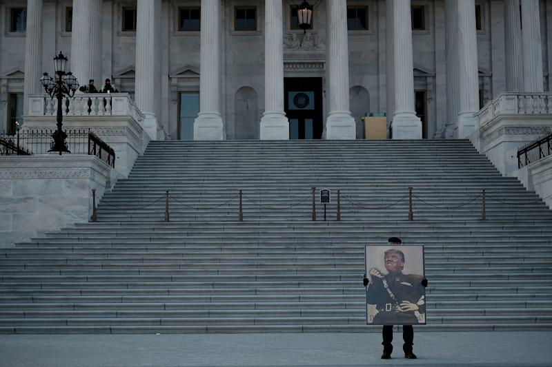 A protestor demonstrates against President Donald Trump in front of the Capitol during the senate impeachment trial in Washington, D.C., on Jan. 29, 2020. | Gabriella Demczuk for TIME