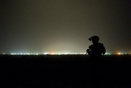 Soldiers from the US Army operating under NATO mount an night-time operating post at Devils hill near the Kandahar Air Field in September 2012. President Barack Obama is weighing plans to keep roughly 10,000 US troops in Afghanistan after the NATO-led force hands over security to the Afghan government, a senior US official said Monday