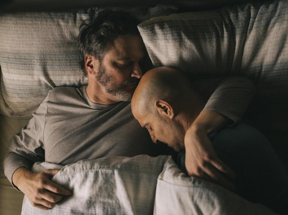 Sam (Colin Firth) and Tusker's (Stanley Tucci) affections are expressed through gestures, not words – in how the two men's bodies fold into each other as they sleep (Studiocanal)