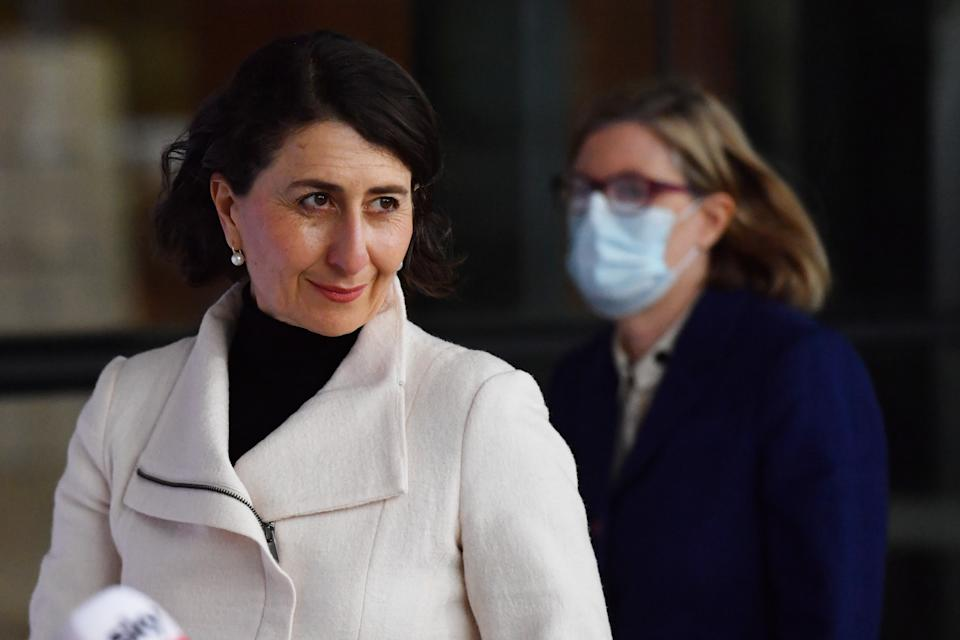 Gladys Berejiklian pictured with Dr Kerry Chant in the background.