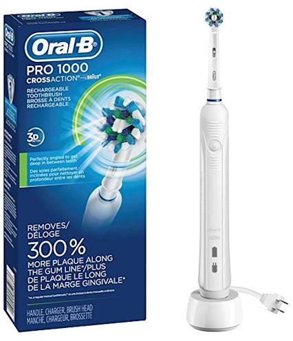 oral b pro 1000 electric toothbrush next to box