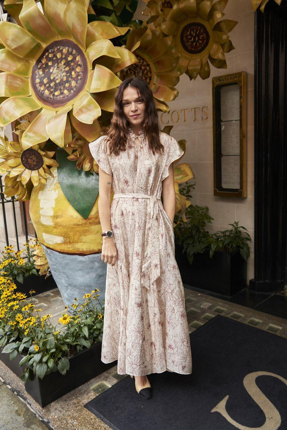 <p><strong>28 September</strong></p><p>Anna Brewster arrived at Scott's wearing a pretty floral-print dress with Chanel pumps and an Omega watch. </p>