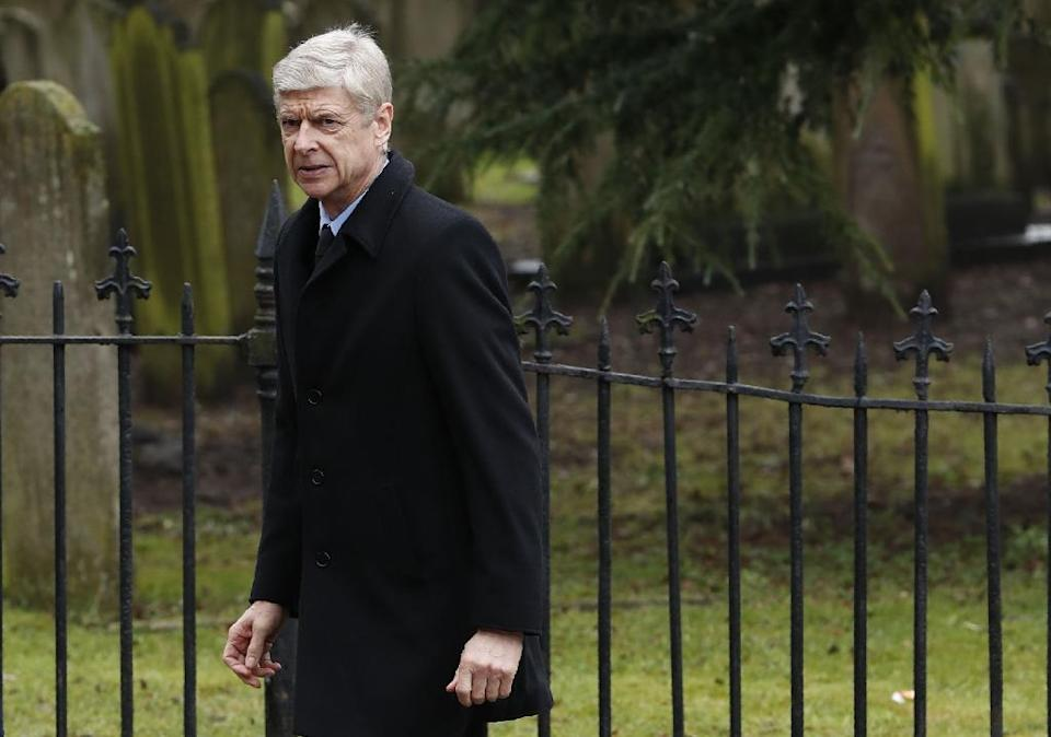 Arsenal's Wenger will go into the game against Hull under heavy pressure after defeats at home to Watford and away at Chelsea have left his a mammoth 12 points behind the latter (AFP Photo/Adrian DENNIS)